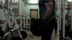 The Athlete in the Gym Doing Exercises - stock footage