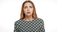 Upset young beautiful blonde girl over white background Stock Footage