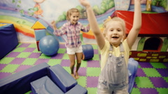 children jumping in the playroom - stock footage