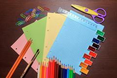 School supplies on dark background. Back to school concept - stock photo