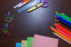 School supplies on dark background with space for text. Back to school concep Stock Photos