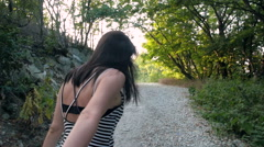 Young Beautiful Brunette Woman Leading By Hand Her Lover On Mountain Road Stock Footage
