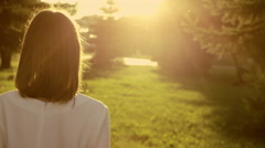 Woman in sunshine rays Stock Footage