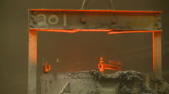 Industrial fire and molten steel cauldron Stock Footage