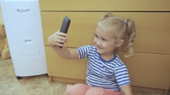Video Chat Conversation.  Little Girl on Smart Phone Talking indoors Using Sm Stock Footage