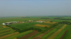 Farm in the village - aerial photography of agricultural fields Stock Footage