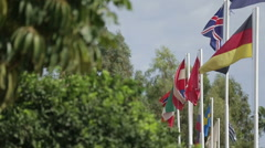 Lots of flags of different countries fluttering in the wind Stock Footage