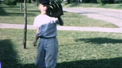 Boy Catches Throws Ball Practice BASEBALL Sport Vintage Film Home Movie 9870 Stock Footage