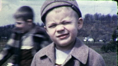 Little Boy Makes Funny Silly Faces Squints 1940s Vintage Film Home Movie 9812 Stock Footage