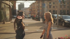 Slow Mo Happy meeting of two friends hugging in the street Stock Footage