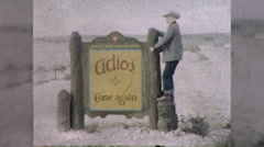Boys Says Goodbye ADIOS NEW MEXICO Sign 1960s Vintage Film Home Movie 9859 Stock Footage