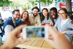 Happy freinds posing for selfie in cafe Stock Photos