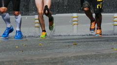 Group of young athletes, runners run through a puddle Stock Footage