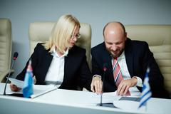 Two politicians in formalwear working with documents Stock Photos