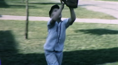 Boy Catches Throws Ball Practice BASEBALL Sport Vintage Film Home Movie 9869 Stock Footage