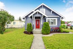Classic American house exterior with siding trim, red entry door and concrete Stock Photos