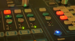 Music mixer in recording studio buttons red lights focus camera sliding Stock Footage
