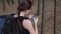 Woman tourist with backpack using navigation app on smartphone in the beautiful Stock Footage