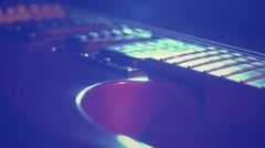 Music guitar strings playing at the party concert studio blue lights Stock Footage
