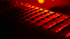 Music guitar strings playing at the party concert studio red lights Stock Footage