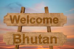 Welcome to  Bhutan sing on wood background Stock Photos
