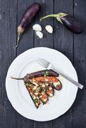 Eggplant with olive oil, basil and cherry tomatoes Stock Photos