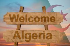 Welcome to Algeria sing on wood background with blending national flag Stock Photos