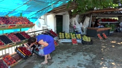 Buyer of nectarines at the roadside fruit market. Chalcidice, Greece Stock Footage