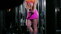 Athletic woman professional bodybuilder demonstrates arm muscles, posing Stock Footage