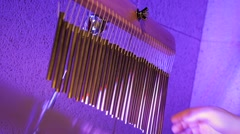 Music instrument at the party in violet lights Stock Footage