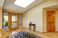 Nice bright entry way to home with hardwood floor and rug. Nortrhwest, USA Stock Photos