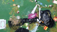 Abuse of environment. Garbage floats in the sea Stock Footage