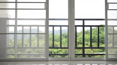 Dolly shot - Mosqito window screen and Glass Door in room Stock Footage