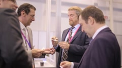 Russia, Novosibirsk, 2015: Respectable men exchange business cards Stock Footage