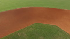 Low flying aerial over empty baseball field in the evening Stock Footage