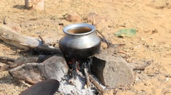 Metal pot with food on fire, Pushkar, India Stock Footage