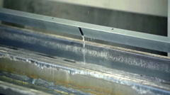 Slowly lifting up material that has been placed in the water Stock Footage