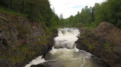 Waterfall in deep coniferous forest Stock Footage