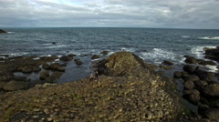 4k Aerial Shot of Giant's Causeway Tourists Waving, Northern Ireland Stock Footage
