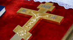 Cross on the table of the priest Stock Footage