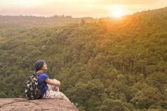 Traveling woman relaxing trekking on rock cliff use for people leisure lifest Stock Photos