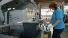 Regulating a machine in the factory Stock Footage