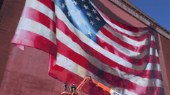 4K Artists Paint Beautiful American Flag Mural On Side Of Old Building ED Stock Footage
