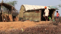 Indian family near the straw home in Pushkar, India Stock Footage