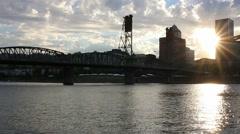 Sunset over skyline of Portland Oregon panning with Hawthorne Bridge 1080p HD Stock Footage