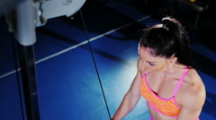 Strong athletic woman training in the gym view from above Stock Footage