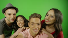 4k Happy friends taking selfie with different poses on green screen. Stock Footage