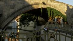 Love locks on railings below the Charles Bridge Stock Footage