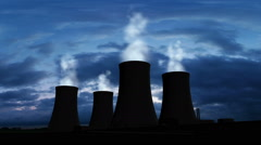 Nuclear Power Station With Steaming Cooling Towers Silhouette Stock Footage