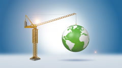 Construction Crane Lifting Green Globe Stock Footage